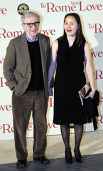 "U.S. director Woody Allen and his wife Soon Yi Previn pose during the premiere of his film ""To Rome with Love"" in Rome"