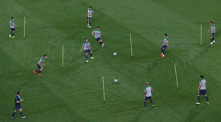 Australia's national soccer team players attend a training session in the Arena Pantanal stadium in Cuiaba
