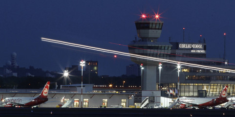 A long exposure shows an aircraft taking off from Berlin's Tegel airport