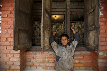 A homeless boy waits for his lunch in Kathmandu