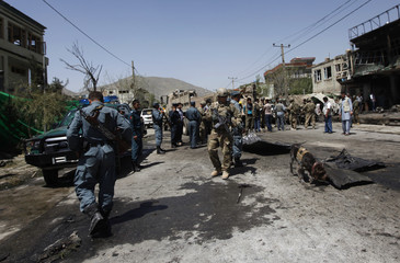 NATO soldiers with the ISAF investigate at the site of a suicide attack in Kabul