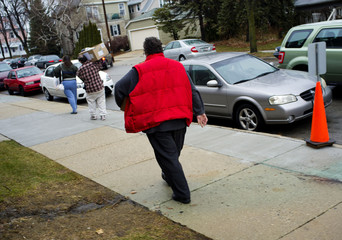 Residents leave Project Concern a non profit center that supplies emergency food and household items to families in need in Cudahy, Wisconsin