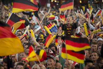 German soccer fans watch the 2014 World Cup Group G soccer match between Germany and Ghana at public viewing zone called 'fan mile' in Berlin