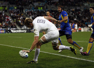 England's Tom Croft scores a try during their Rugby World Cup Pool B match against Romania at Otago Stadium in Dunedin