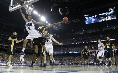Bulldogs' Nored loses control of ball against the Rams during their semi-final NCAA Final Four college basketball game in Houston