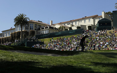 Japan's Ryo Ishikawa chips to the eighth green with the clubhouse in the background during the second round of the 2012 U.S. Open golf tournament on the Lake Course at the Olympic Club in San Francisco