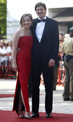 German Families Minister Kristina Schroeder and her husband Ole arrive for opening of Bayreuth Wagner opera festival in Bayreuth