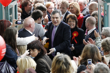 Britain's Prime Minister Gordon Brown arrives to meet supporters at the Concourse shopping centre in Skelmersdale