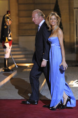 French Interior Minister Hortefeux and his wife arrive at the Elysee to attend a dinner