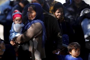 Migrants wait to enter registration camp in Preshevo