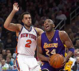 Los Angeles Lakers' Bryant looks to shoot ball past New York Knicks' Fields in NBA game in New York