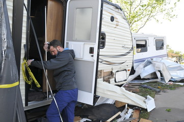 Jarrod McGee attempts to get into his destroyed camper at the Roadrunner RV Park in Oklahoma City, Oklahoma