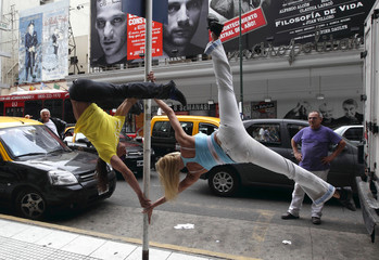 Performers do a pole dancing routine to promote the Miss Pole Dance South America 2012 competition in Buenos Aires