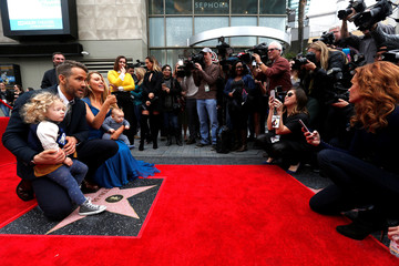 Actor Ryan Reynolds with his daughters James and wife Lively pose on his star on the Hollywood Walk of Fame in Hollywood
