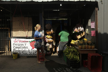 A tourist is seen at the local market in Boquete town