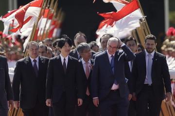 Japan's Prince Akishino walks with Cunha in Brasilia
