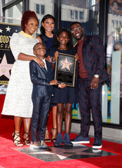 Actor Kevin Hart poses with his family including his former wife, and mom of his kids, Torrei Hart, his wife Eniko Parrish, son Hendrix Hart and daughter Heaven Hart during a ceremony honoring him with a star on the Hollywood Walk of Fame in Hollywood