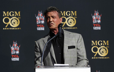 Stallone speaks at a paw print ceremony for MGM mascot Leo the Lion in the forecourt of the TCL Chinese theatre in Hollywood