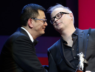Director Wong presents the Silver Bear for Alfred Bauer Prize to director Cote during the awards ceremony at the 63rd Berlinale International Film Festival in Berlin