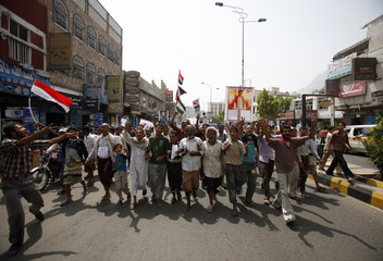 Anti-government protesters march to demand the ouster of Yemen's President Ali Abdullah Saleh in Taiz