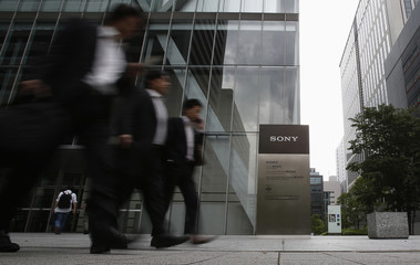 People walk out from Sony Corp's headquarters in Tokyo
