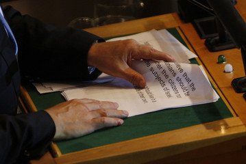 Israeli Prime Minister Benjamin Netanyahu turns a page as he reads from prepared remarks during his address before the 66th United Nations General Assembly at the U.N. headquarters in New York