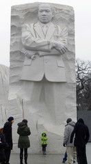 A young child has her picture taken at the Martin Luther King, Jr. Memorial in Washington