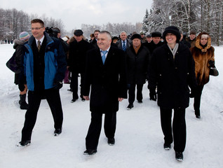 The ISS crew of Russian cosmonaut Yurchikhin and U.S. astronauts Wheelock and Walker walk during a traditional welcoming ceremony in Star City outside Moscow