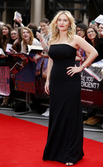 """Actress Kate Winslet poses for a photograph as she arrives for the European premiere of """"Divergent"""" at Leicester Square in London"""