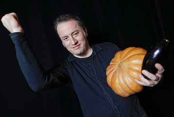 Austrian musician Jurgen Berlakovich, a member of the Vegetable Orchestra, poses for a picture with a musical instrument made from vegetables in Haguenau, eastern France