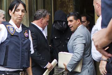 Detective Wojciech Braszczok exits the criminal court in Manhattan, New York