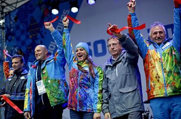 Russian pole vaulter Isinbayeva, mayor of the Olympic Village cuts a ribbon to open the Coastal Athletes Village for the 2014 Sochi Winter Olympics