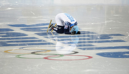 Victor An of Russia reacts on the ice as he wins the men's 1,000 metres short track speed skating final event at the Iceberg Skating Palace during the 2014 Sochi Winter Olympics