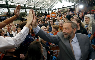 Canada's New Democratic Party (NDP) leader Thomas Mulcair greets supporters at a campaign event in Victoria