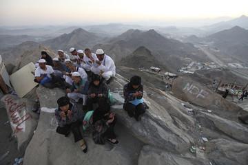 Muslim pilgrims pray atop Mount Al-Noor during the annual haj pilgrimage in Mecca