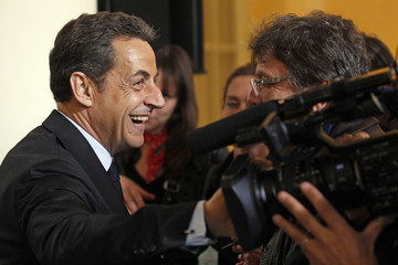 France's President  Sarkozy speaks with journalists before a news conference at the Corsica prefecture in Ajaccio