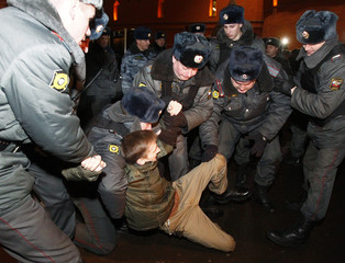 Police detain a nationalist activist during a protest rally against parliamentary elections after voting closed in central Moscow