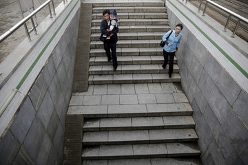 People enter an underground crossing in central Pyongyang