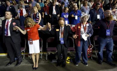 Delegates and alternates pray at the Colorado Republican state convention in Colorado Springs