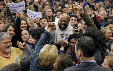 U.S. Democratic presidential candidate Hillary Clinton greets audience members at a campaign rally in Portsmouth