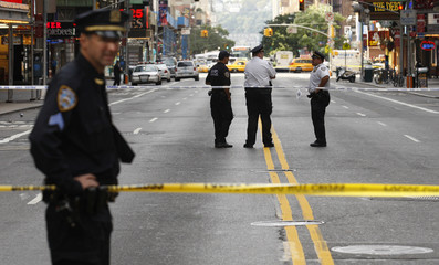 N.Y. City police officers secure a zone while investigating a suspicious package left near Times Square in New York
