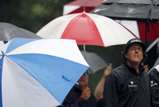 Phil Mickelson of the U.S. looks up into the sky from the second tee during the final round of the BMW Championship golf tournament at the Conway Farms Golf Club in Lake Forest, Illinois