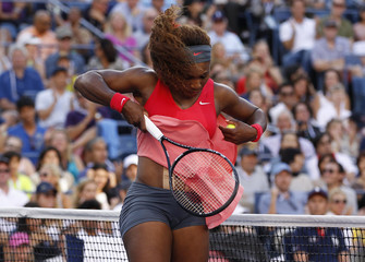 Serena Williams of the U.S. has her skirt blown up by the wind during her women's singles final match against Azarenka of Belarus at the U.S. Open tennis championships in New York
