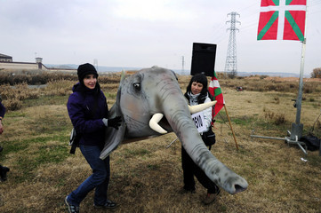 Supporters of Otegi hold up an elephant head made of foam during a protest calling for his release in front of the Logrono prison
