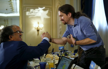 Spain's Podemos (We Can) party leader Pablo Iglesias greets a man after a conference in Madrid, Spain
