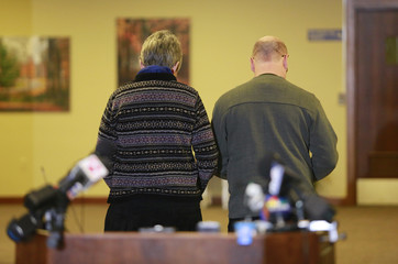 Paula and Ed Kassig, parents of U.S. aid worker Peter Kassig, leave the podium area after reading a statement to the press in Indianapolis
