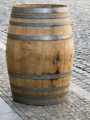 Wooden barrel on paving stones