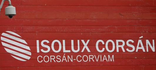 A surveillance camera is seen over a placard with the logo of Spanish construction company Isolux Corsan in Madrid,