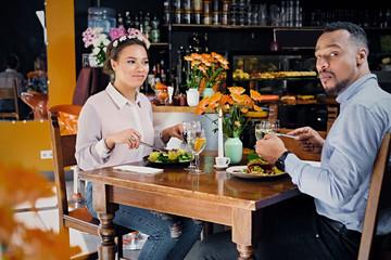Black American male and female eating vegan food.