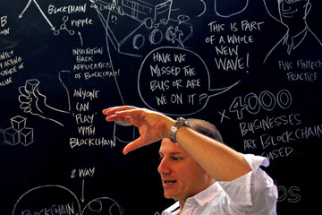 Alex Scandurra, CEO of Sydney fintech hub Stone & Chalk, talks in front of a drawing board located in the company's offices in central Sydney